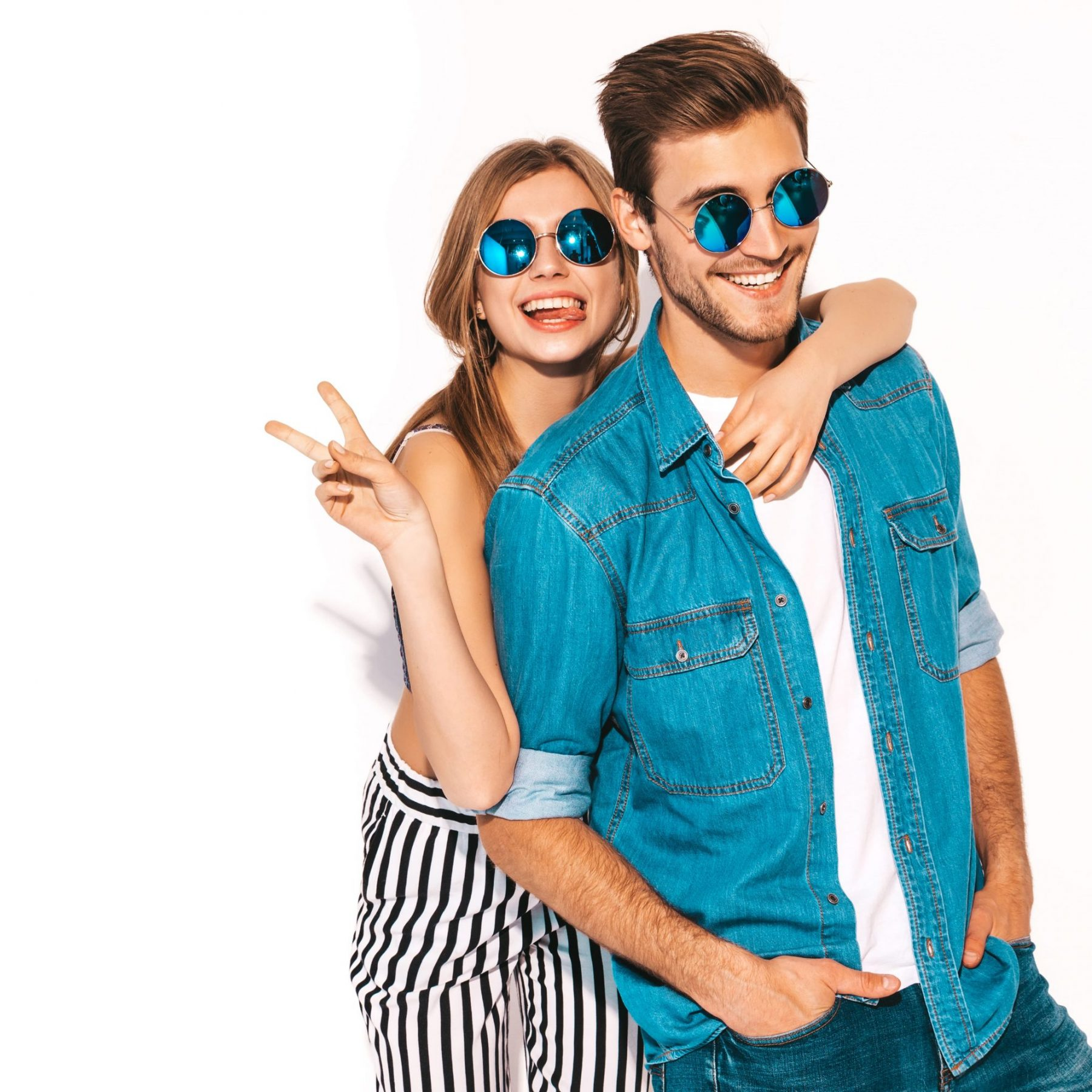 portrait-of-smiling-beautiful-girl-and-her-handsome-boyfriend-laughing-happy-cheerful-couple-in-sunglasses-and-showing-peace-sign (1)